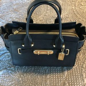 4aba54da4 Coach. Coach Swagger Carryall 27 in black pebble leather